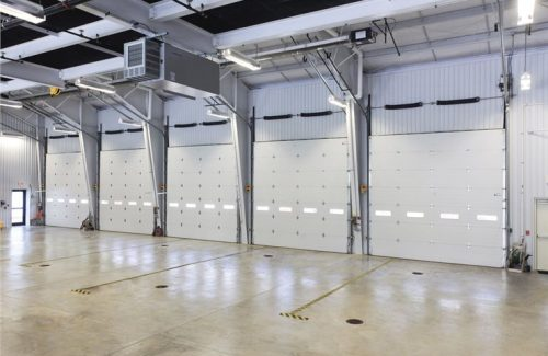 Row of white commercial garage doors