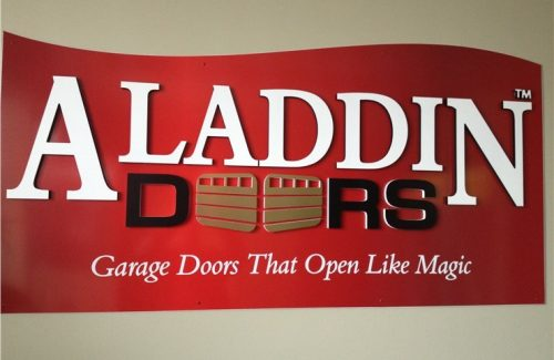 Aladdin Doors sign on wall