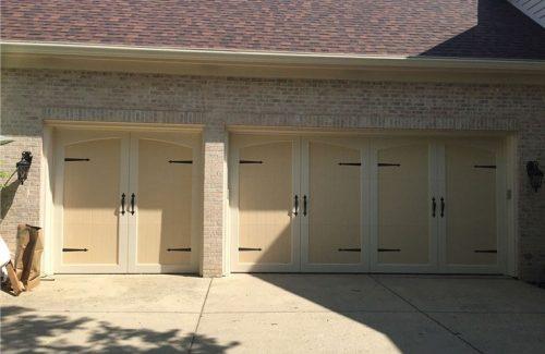 yellow garage doors on white brick garage