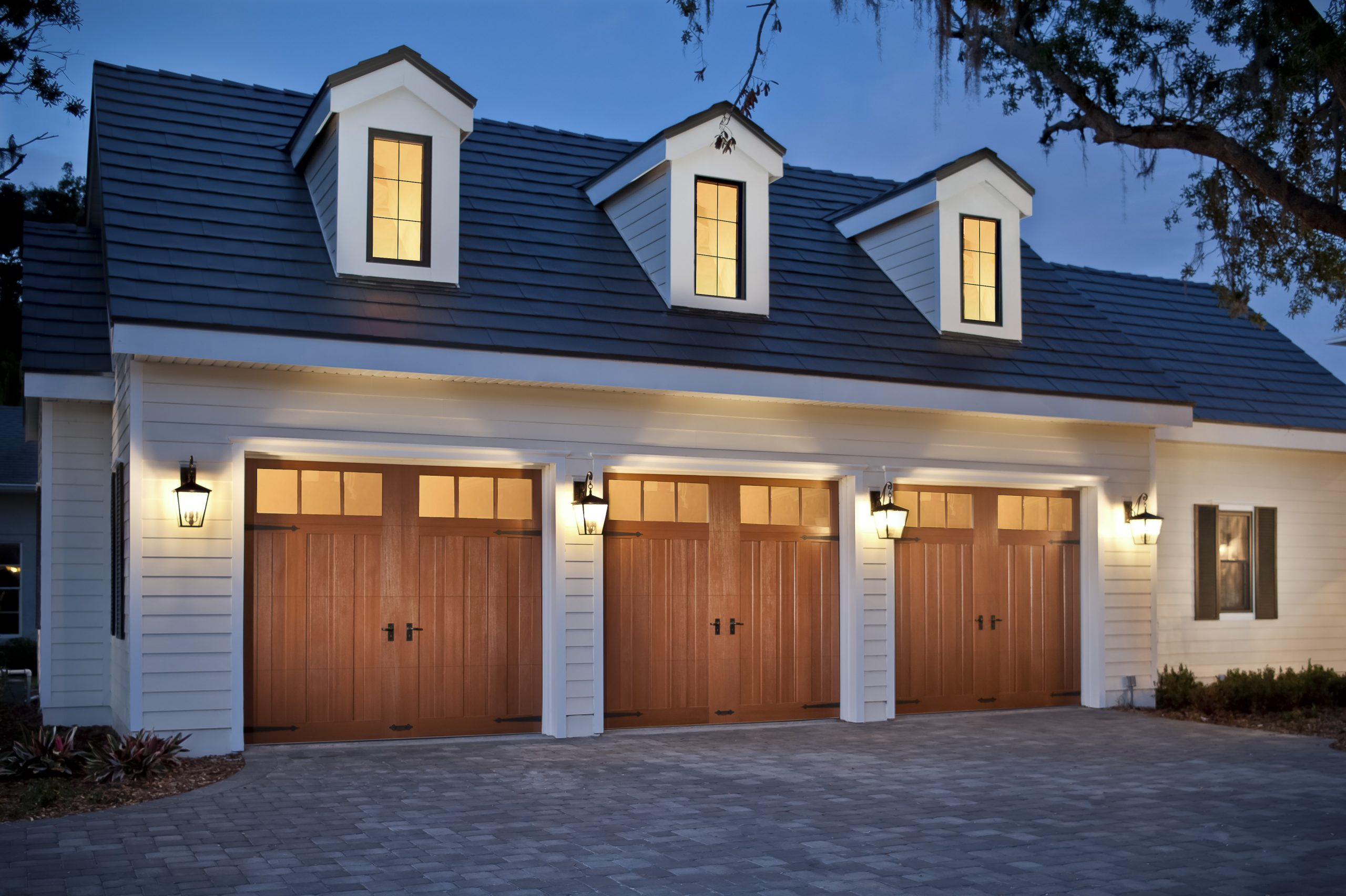 residential house with brown wooden garage doors