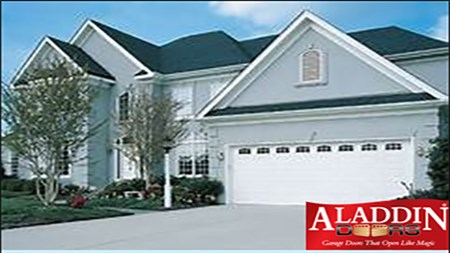gray house with white garage door