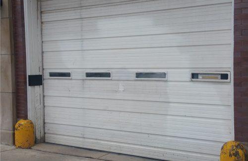 white metal commercial garage door