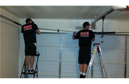 people working on garage doors
