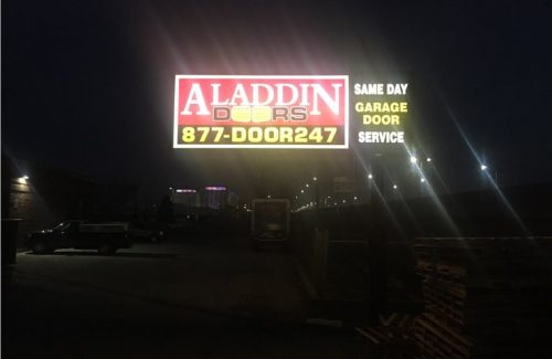 aladdin doors sign lit up at night