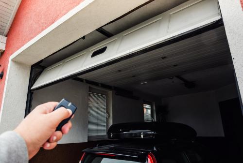 person closing garage door with fob