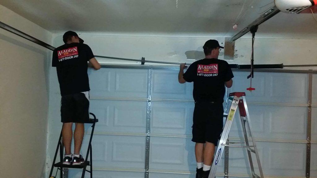 specialists replacing garage door spring