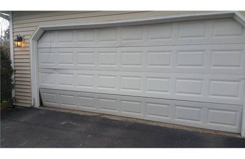busted white garage door