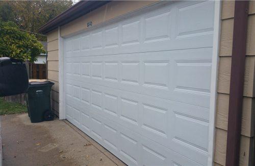 white garage door on tan garage after