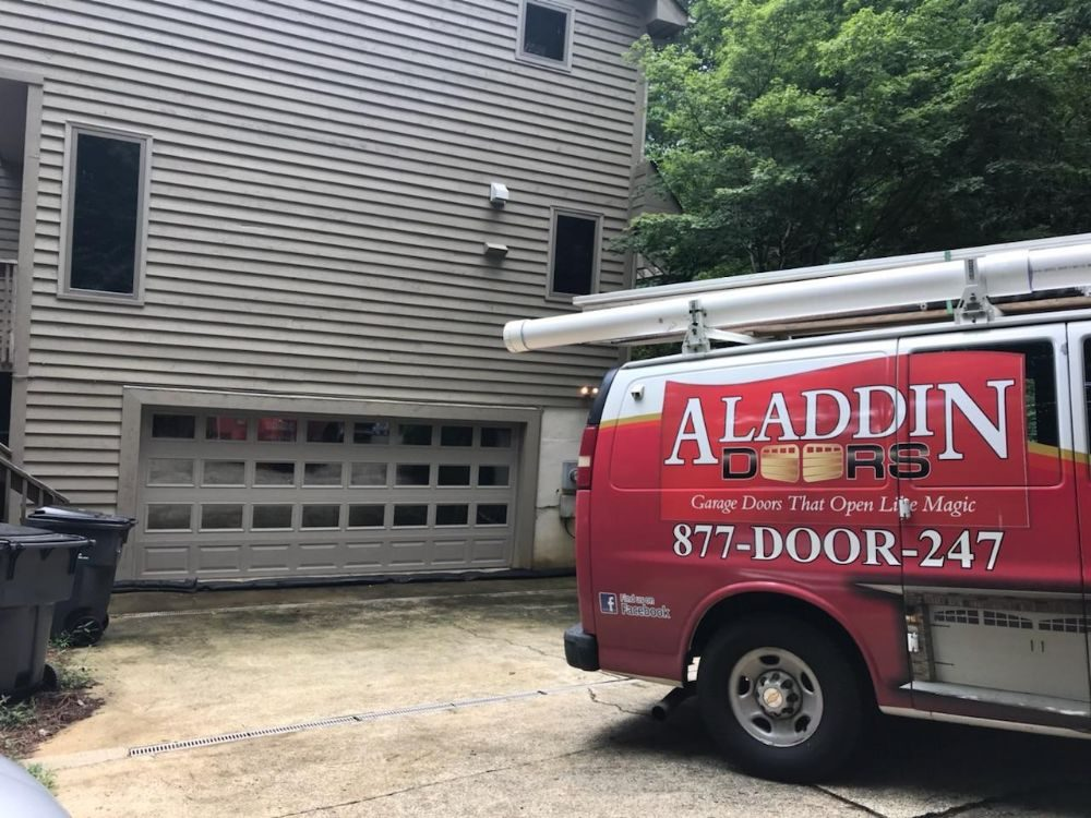 aladdin garage door worker repairing garage door