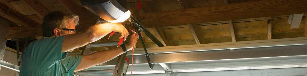 man repairing garage door opener