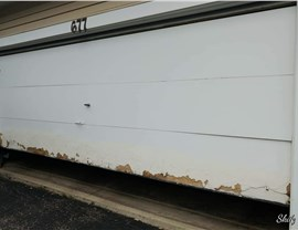 white garage door with chipped paint